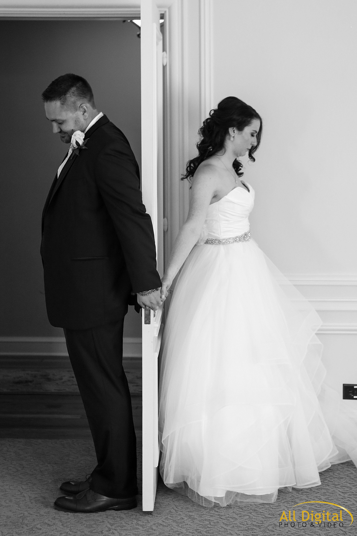 Bride & Groom holding hands separated by a door at Highlands Ranch Mansion.