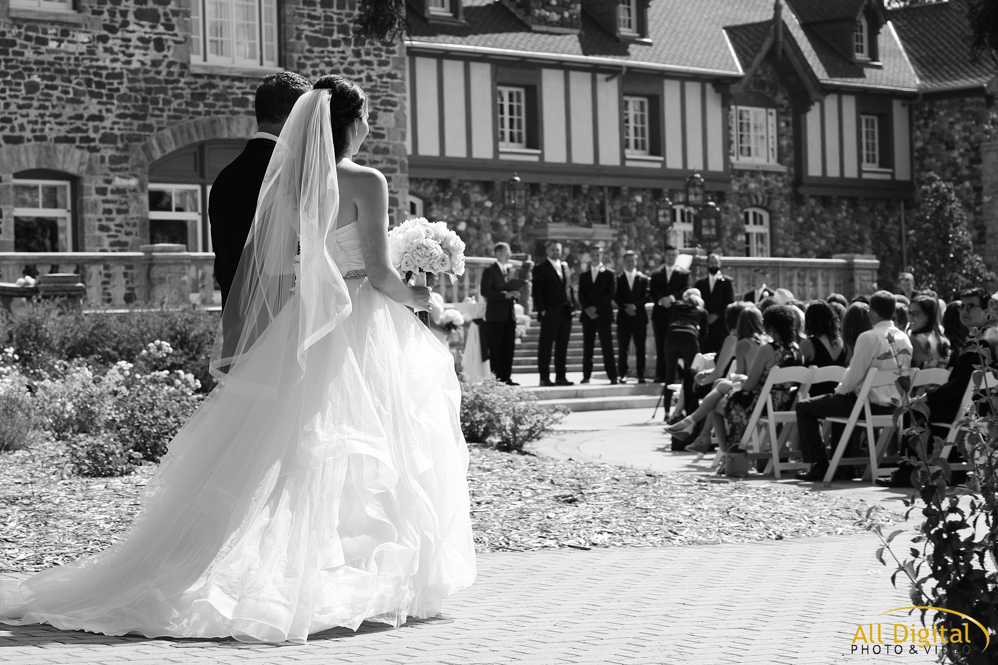 Bride walking down the aisle at Highlands Ranch Mansion.