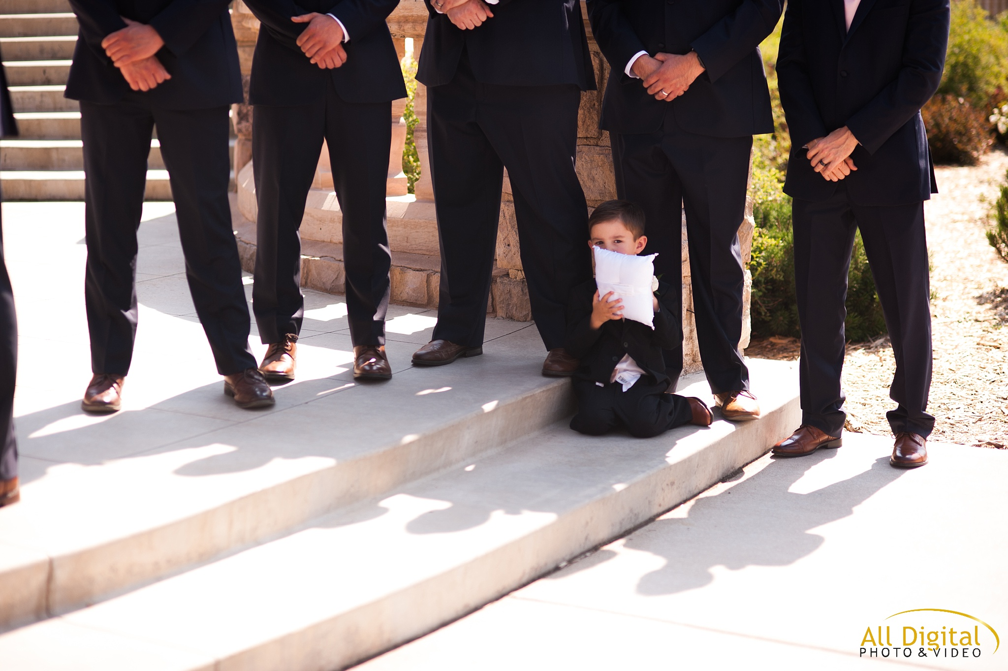 Ring Bearer sitting on the steps of the alter at Highlands Ranch Mansion